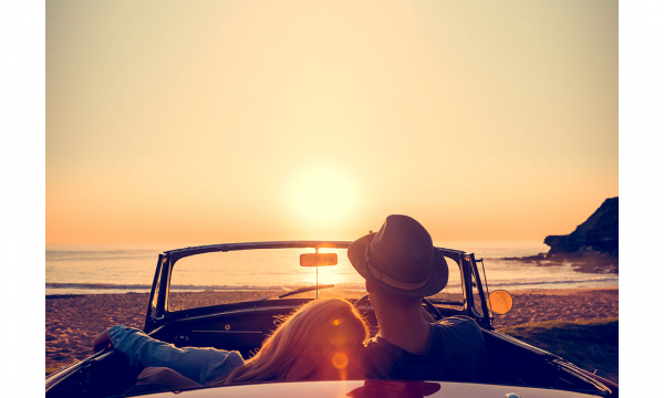 Couple in a car watching the sunset